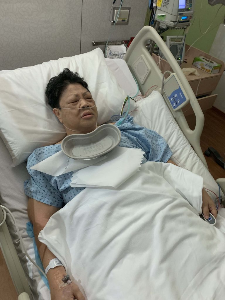 Mum finally out! Operation successful! But she's still in pain from the surgery.