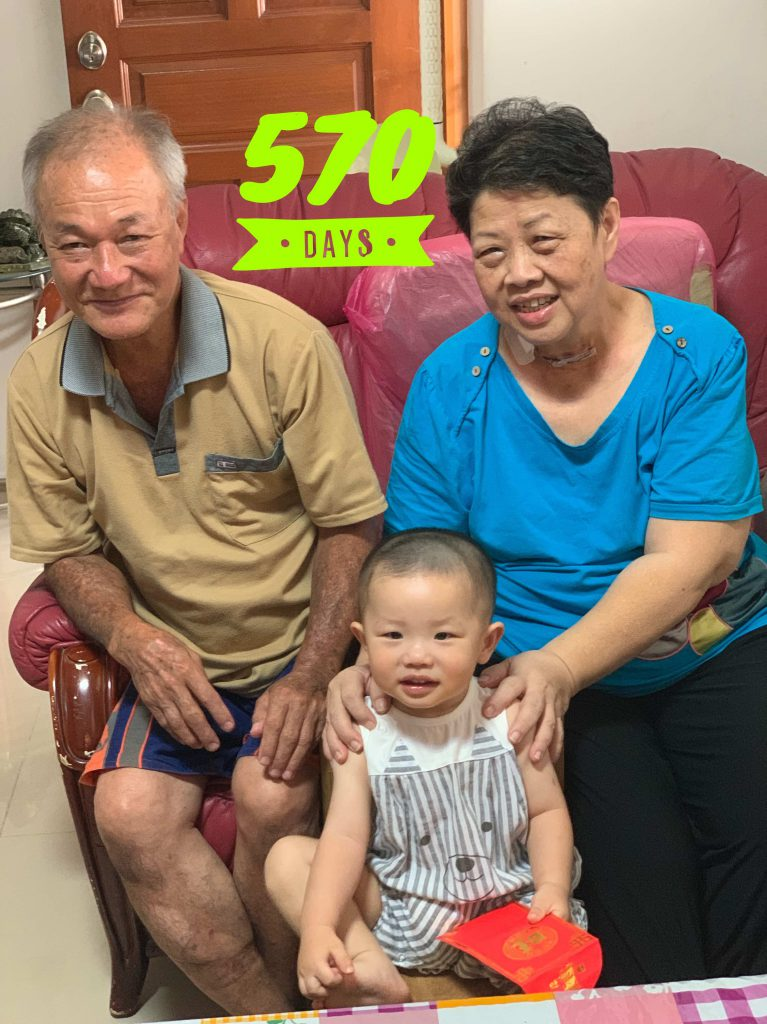 Lucas Day 570, photo with grandpa and grandma!