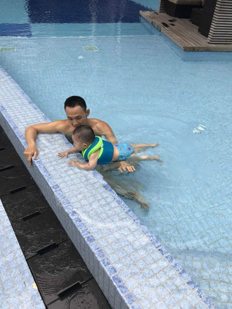 Teaching Lucas how to swim...