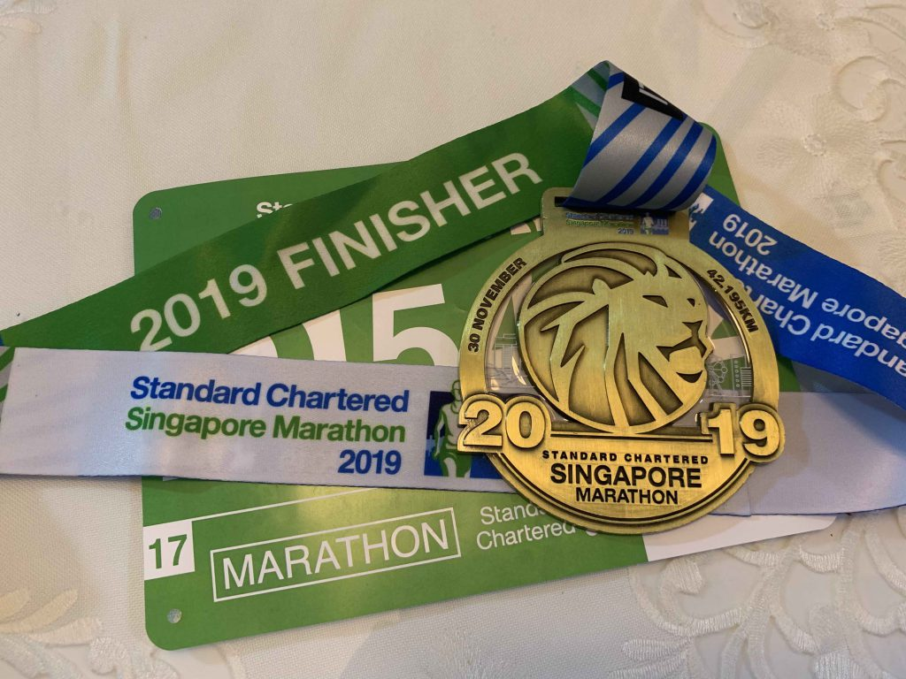 Finally finished my 10th marathon! Promised myself to run 10 in 2011 and i actually did it! First one was so scary, then got so used to it now. Shall try something different...  I like this year's route and timing! Starting at 6pm means can still go home and have a nice hot shower and go to bed! The west coast and ecp route helps break the monotony of running a very long stretch of road.