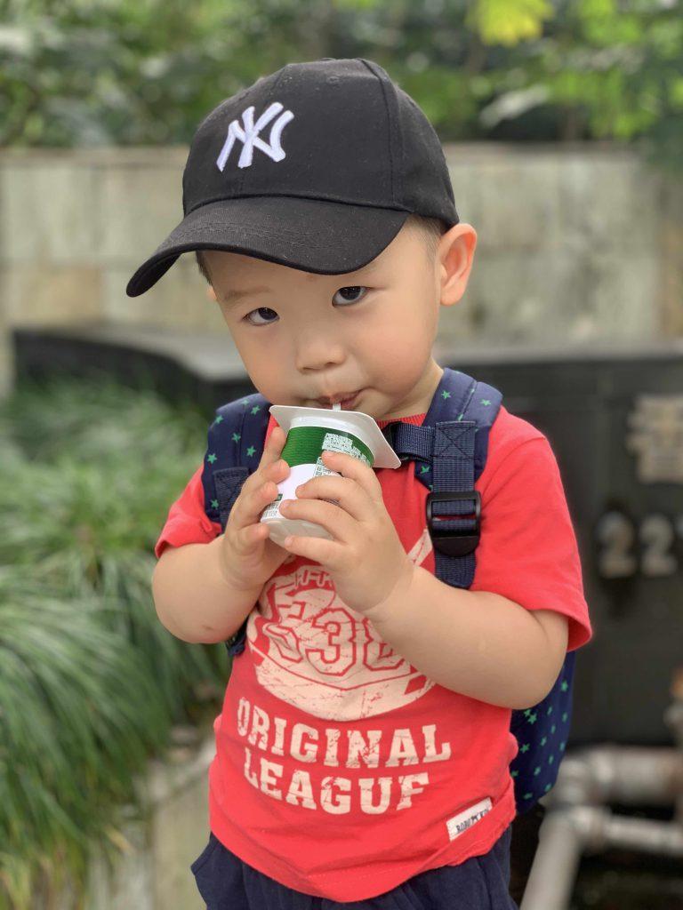 Drinking his yogurt after school!