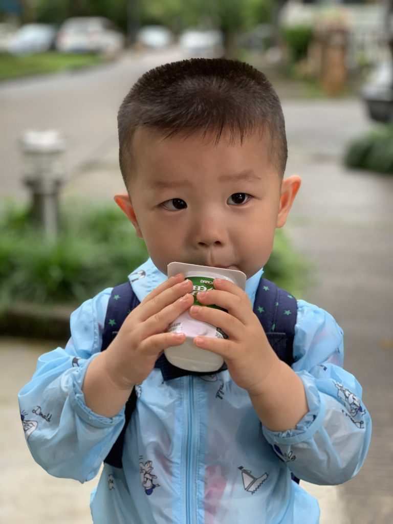 Drinking his favourite yogurt after school!