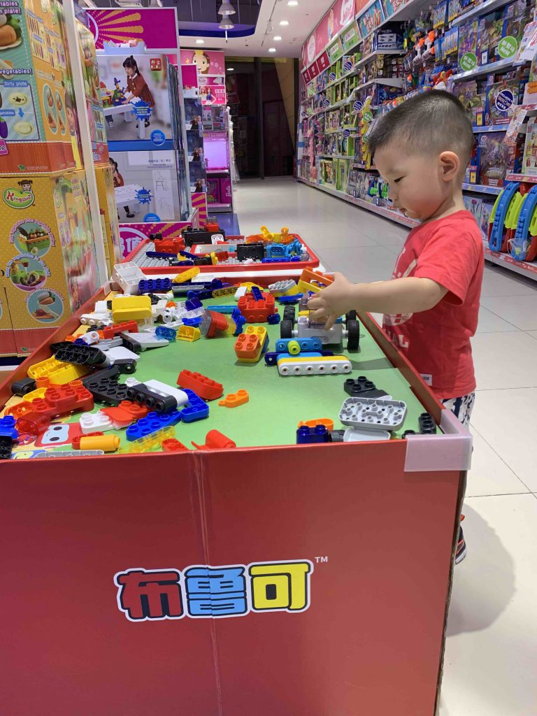 Playing all the toys at Toys R Us!